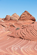 Pyramid shaped sandstone rock formations at Coyote Buttes North, part of the Paria Canyon-Vermilion Cliffs Wilderness area.