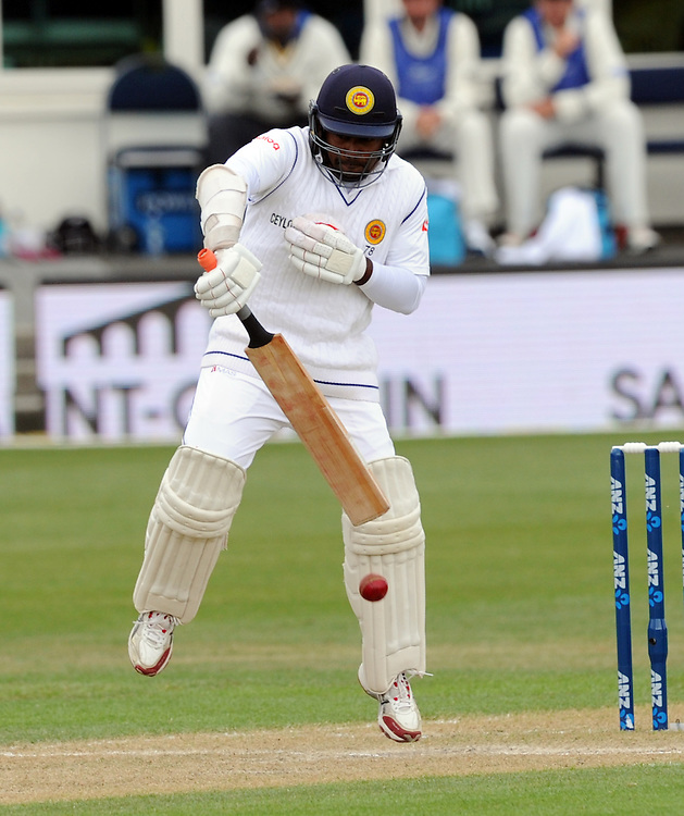 Sri Lanka's Rangara Herath plays defensively against New Zealand on day three of the first International Cricket Test, University Cricket Oval, Dunedin, New Zealand, Saturday, December 12, 2015. Credit:SNPA / Ross Setford