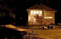 09 December, 05. New Orleans, Louisiana. Hurricane Katrina aftermath.<br /> Matt McCarthy and his daughter put up lights in their devastated uptown street. McCarthy, a Vietnam veteran who lost all his precious 8mm films and slides from his time as a soldier in the late 60's puts up Christmas lights with his daughter Eileen. McCarthy has had a rough 12 months. He lost a kidney, his wife died of cancer and he lost everything in his home. He and his daughter, the only residents to return to State St Drive in what was flooded 'uptown' put lights on the dead tree in their front yard. <br /> Photo; ©Charlie Varley/varleypix.com
