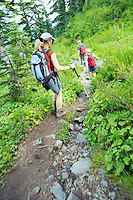 Hikers on a trail in Central Cascades Range Washington USA.