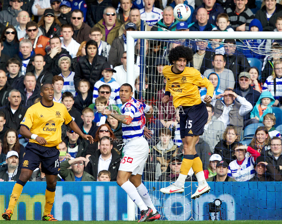 LONDON, ENGLAND - Saturday, March 3, 2012: Everton's Marouane Fellaini and Sylvain Distin in action against Queens Park Rangers' Anton Ferdinand during the Premiership match at Loftus Road. (Pic by Vegard Grott/Propaganda)
