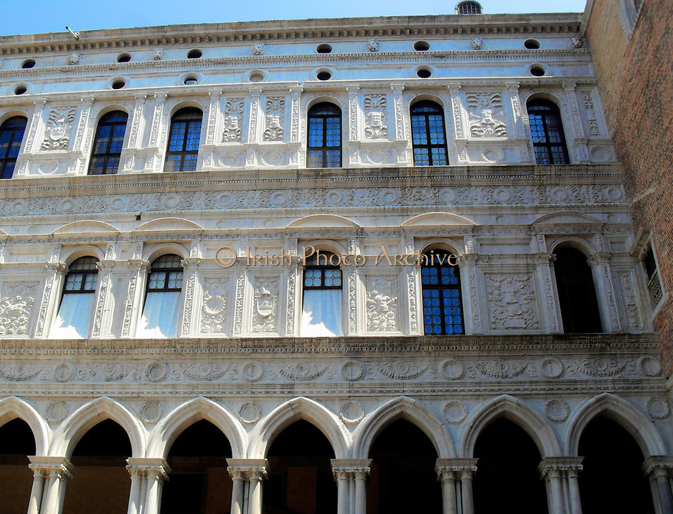 Detail of the Doge's Palace Courtyard, Venice. Built in Venetian Gothic style the palace was the residence of the Doge of Venice (the supreme authority of the rublic of Venice). It is now open as a museum.