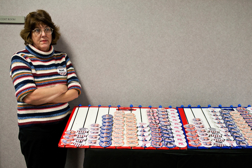 A woman stands near political buttons for sale as she waits for Republican presidential candidate Newt Gingrich to address the Polk County Republican Party's Robb Kelley Victory Club dinner on Thursday, December 1, 2011 in Johnston, IA.
