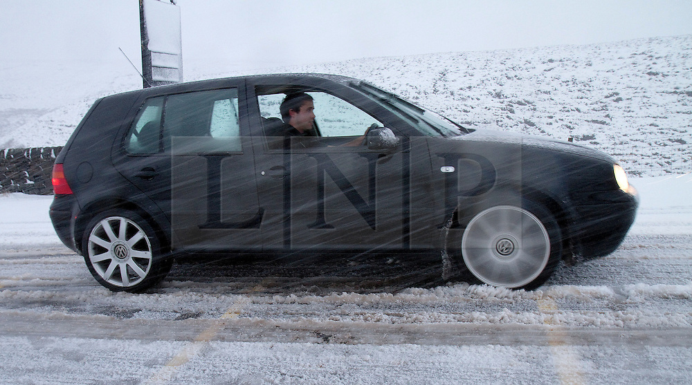 © Licensed to London News Pictures. 27/01/2012. Derbyshire, UK. A drivers struggles through snow and ice along Peak District's notorious Snake Pass Road between Manchester and Sheffield on January 27th, 2012. Photo credit : Joel Goodman/LNP