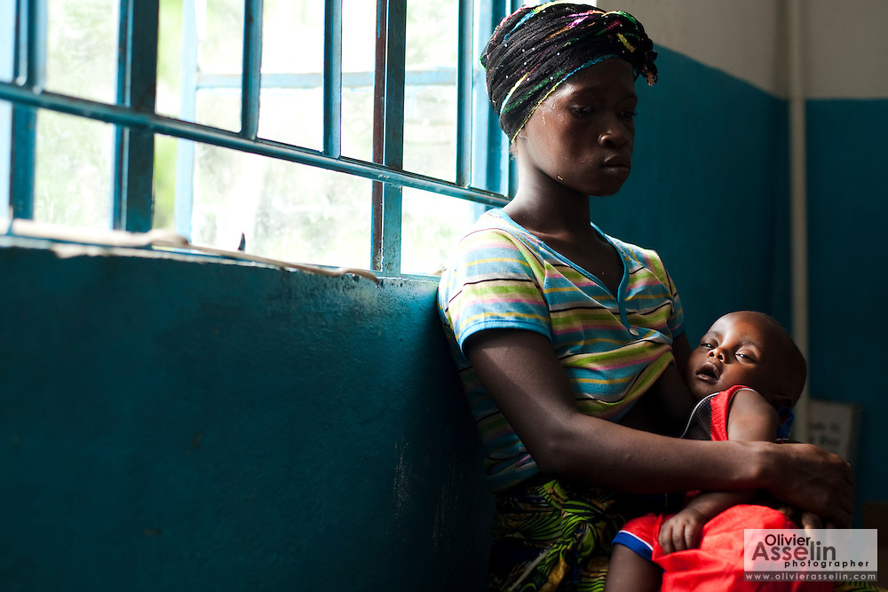 Marie Tabeh sits with her two-year-old son Blackie, who suffers from severe dehydration, as she waits to see the nurse at the Yoni PHU in the village of Yoni, on Sherbro Island, Sierra Leone on Thursday April 22, 2010.