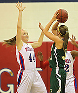 Washington's Kelli Klaus (44) tries to block a shot by West's McKenzie Piper (31) during the girl's high school basketball game between Iowa City West and Cedar Rapids Washington at Washington High School, 2205 Forest Drive SE, in Cedar Rapids, on Tuesday evening, January 3, 2012. (Stephen Mally/Freelance)