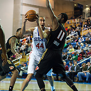 Delaware 87ers Center Ben Strong (44) drives towards the basket as Erie BayHawks Forward CJ Leslie (11) defends in the paint in the first half of a NBA D-league regular season basketball game between Delaware 87ers (76ers) and the Erie BayHawks (Knicks) Friday, Jan. 3, 2014 at The Bob Carpenter Sports Convocation Center, Newark, DE