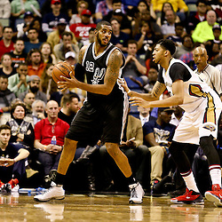 Mar 3, 2016; New Orleans, LA, USA; San Antonio Spurs forward LaMarcus Aldridge (12) is defended by New Orleans Pelicans forward Anthony Davis (23) during the second quarter of a game at the Smoothie King Center. Mandatory Credit: Derick E. Hingle-USA TODAY Sports