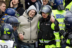 © under license to London News Pictures. 05/02/2011. An injured EDL Supporter. Thousands of English Defence League members and supporters march through Luton Town Centre to demonstrate against Sharia Law. 2000 police are in the town to keep the peace. Joel Goodman/London News Pictures