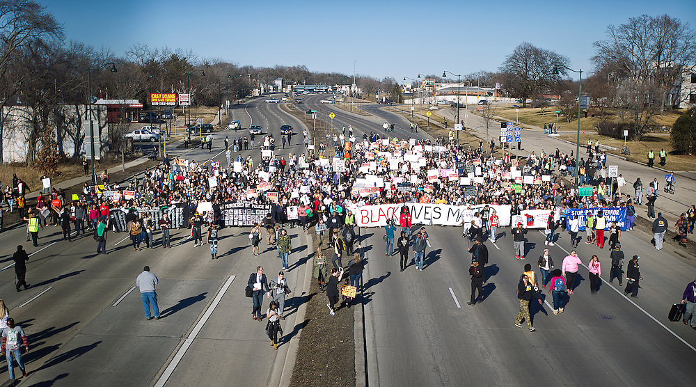 Protestors march down Washington Avenue outside the Wisconsin Department of Corrections to protest the shooting death of Tony Robinson, Jr., March 11, 2015. Protestors rallied for the fifth day in a row, after Robinson's death by Madison Police inside his home on March 6, 2015. REUTERS/Ben Brewer (UNITED STATES)