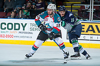 KELOWNA, CANADA - APRIL 25: Alexander True #16 of the Seattle Thunderbirds back checks Dillon Dube #19 of the Kelowna Rockets as he skates with the puck during first period on April 25, 2017 at Prospera Place in Kelowna, British Columbia, Canada.  (Photo by Marissa Baecker/Shoot the Breeze)  *** Local Caption ***