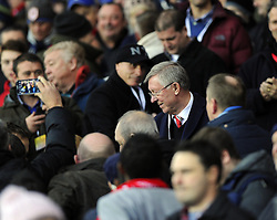 Sir Alex Ferguson is mobbed by fans in the stand  - Photo mandatory by-line: Joseph Meredith/JMP - Tel: Mobile: 07966 386802 - 24/11/2013 - SPORT - FOOTBALL - Cardiff City Stadium - Cardiff City v Manchester United - Barclays Premier League.