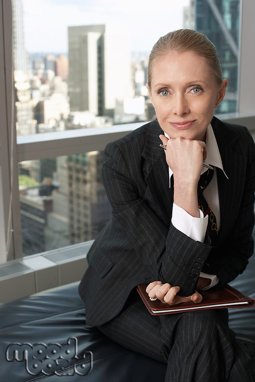 Businesswoman sitting in office lobby portrait