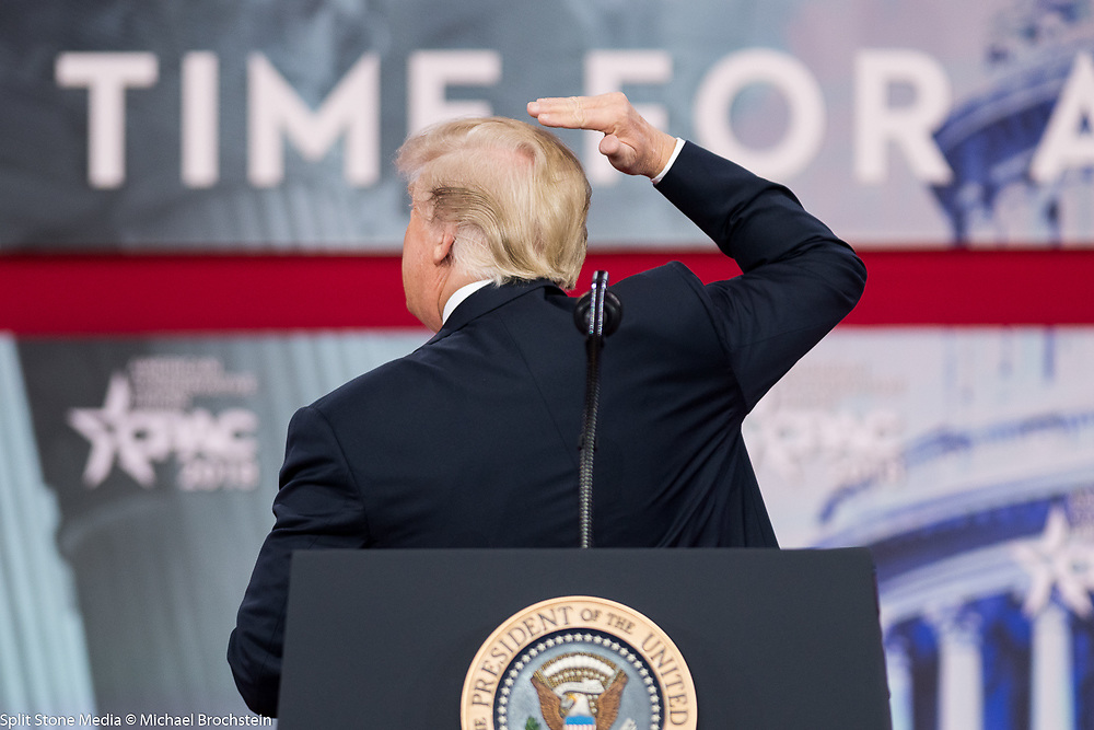 President Donald Trump (explicitly) showing off his hair at the Conservative Political Action Conference (CPAC) sponsored by the American Conservative Union held at the Gaylord National Resort & Convention Center in Oxon Hill, MD on February 23, 2018. Recently there had been a video showing his hair being blown astray and the president wanted to show how it should / did look.