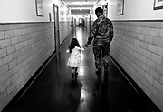 Emily, 4, walks the halls of the National Guard Family Assistance Center in the Teaneck Armory with Sgt. Scott at an event for families of soldiers deployed to Iraq.
