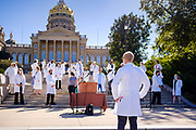 01 AUGUST 2020 - DES MOINES, IOWA: at the Iowa State Capitol Saturday. About 50 doctors, medical professionals, and public health professionals from across Iowa came to the State Capitol to demand that Iowa Governor Kim Reynolds impose a mask mandate to control the spread of the coronavirus (SARS-CoV-2). Despite the continued spread of the coronavirus and rapidly increasing infection rate for COVID-19, the Governor has refused to impose a mask mandate or close businesses. For the week ending Saturday, Aug. 1, Iowa reported new 2,736 new cases of COVID-19.             PHOTO BY JACK KURTZ