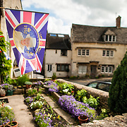 A garden of a home in Painswick in the Cotswolds. At left is a flag commemorating the diamond jubilee of Queen Elizabeth II.