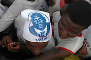 Supporters of former soccer star George Weah attend a rally in Monrovia.
