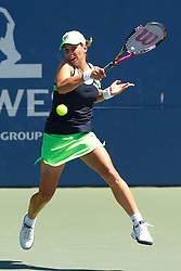July 28, 2011; Stanford, CA, USA;  Marina Erakovic (NZL) returns the ball against Victoria Azarenka (BLR), not pictured, during the second round of the Bank of the West Classic women's tennis tournament at the Taube Family Tennis Stadium. Erakovic defeated Ararenka 4-6, 7-5, 6-2.