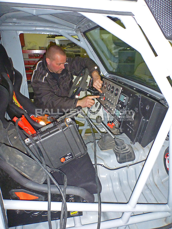 Products.<br /> Hellpower Battery Case being used to jump start a rallye car..