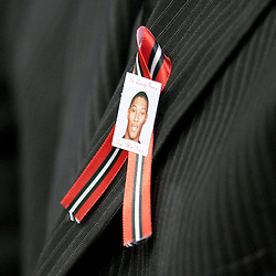 Dec 22, 2009; Westwego, LA, USA;  A pin depicting Chris Henry is worn by a friend during funeral services for Cincinnati Bengals wide receiver Chris Henry held at the Alario Center. Mandatory Credit: Derick E. Hingle-US PRESSWIRE