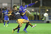 Bayo Akinfenwa of AFC Wimbledon during the Sky Bet League 2 match between AFC Wimbledon and Cambridge United at the Cherry Red Records Stadium, Kingston, England on 18 August 2015. Photo by Stuart Butcher.