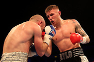 Paul Hyland Jr (right) in action against Stephen Ormond during their IBF East/West Europe Lightweight Championship bout at the SSE Arena, Belfast.