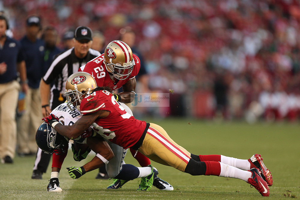 Seattle Seahawks wide receiver Ben Obomanu (87) catches a pass against San Francisco 49ers cornerback Chris Culliver (29) and safety Dashon Goldson (38) on Thursday, Oct. 18, 2012 at Candlestick Park in San Francisco. (AP Photo/Jed Jacobsohn)