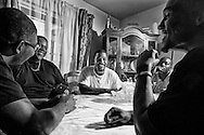 A group of ex convicts discuss politics before the second debate from a home during a watch party in SouthEast San Diego, CA on Sunday, October 9, 2016.(Photo by Sandy Huffaker/Politico)