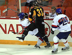 Dominik Granak of Slovakia and Michael Hackert of Germany at ice-hockey match Germany (played in old replika jerseys from year 1946) vs Slovakia at Preliminary Round (group C) of IIHF WC 2008 in Halifax, on May 05, 2008 in Metro Center, Halifax, Nova Scotia, Canada. Germany won 4:2. (Photo by Vid Ponikvar / Sportal Images)