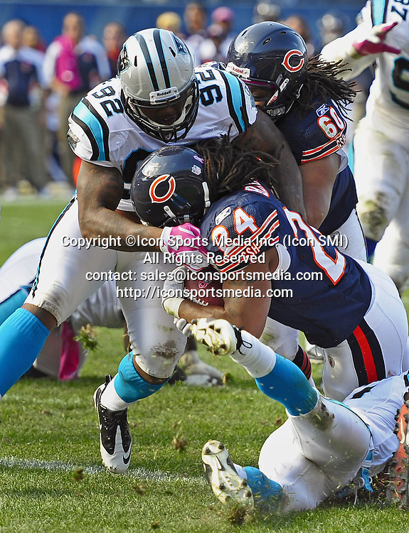 Oct. 2, 2011 - Chicago, IL, USA - Carolina Panthers defensive end Eric Norwood is unable to stop Chicago Bears running back Marion Barber (24) on a touchdown run during game action at Soldier Field in Chicago, Illinois, Sunday, October 2, 2011. The Bears defeated the Panthers 34-29