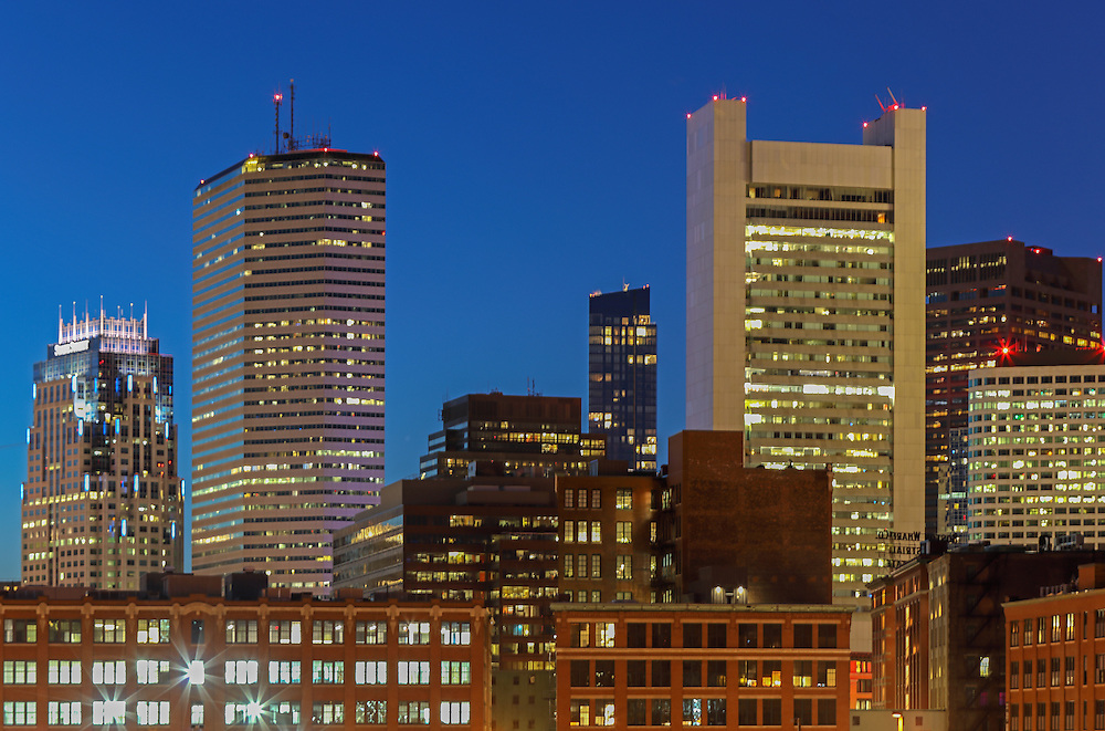 The Hub presenting Boston skyline photos featuring iconic skyscrapers and some of the tallest buildings in Boston such as the Boston State Street Corporation, The Federal Reserve Bank of Boston, the Boston Millennium Tower and the One Financial Center at Dewey Square on a magnificent night at twilight. This Boston skyline photograph at twilight is available as museum quality photography prints, canvas prints, acrylic prints or metal prints. Fine art prints may be framed and matted to the individual liking and decorating needs:<br />