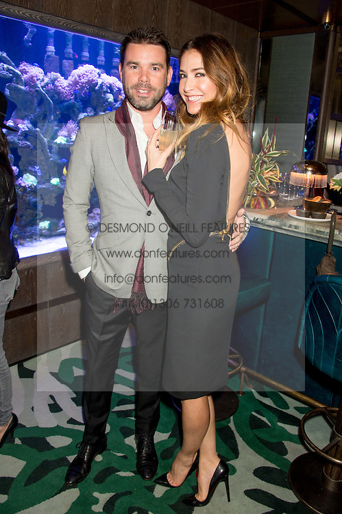 TV & Radio presenter DAVE BERRY and LISA SNOWDON at a party to celebrate the launch of the Lisa Snowdon jewellery collection for QVC held at Sexy Fish, Berkeley Square, London on 12th January 2016.