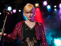 Young Woman Singing in Concert on stage front view low angle view