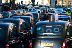 Whitehall, London, February 10th 2016. Taxis at a standstill as an estimated 8,000 cabbies hold a go-slow in protest against what they say is unfair competition from minicab and Uber drivers who do not have to undergo the rigorous training and checks required for the licenced taxi trade. ///FOR LICENCING CONTACT: paul@pauldaveycreative.co.uk TEL:+44 (0) 7966 016 296 or +44 (0) 20 8969 6875. ©2015 Paul R Davey. All rights reserved.