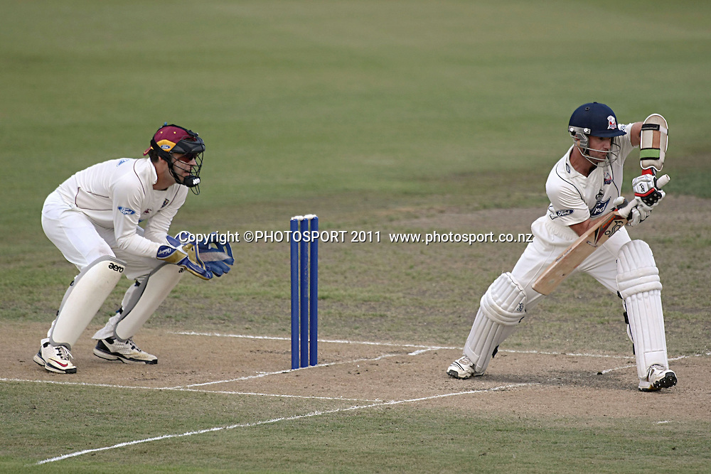 Auckland Ace's Gareth Hopkins in full defense mode as knights keeper Peter McGlashan looks on Cricket, Northern Knights Vs The Auckland Ace's during day two of their Plunket Shield Game at Seddon Park in Hamilton, Wednesday 16 March 2011.<br /> Photo: Dion Mellow / photosport.co.nz