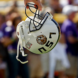 October 22, 2011; Baton Rouge, LA, USA; LSU Tigers quarterback Jarrett Lee (12) holds is helmet prior to kickoff of a game against the Auburn Tigers at Tiger Stadium.  Mandatory Credit: Derick E. Hingle-US PRESSWIRE / © Derick E. Hingle 2011