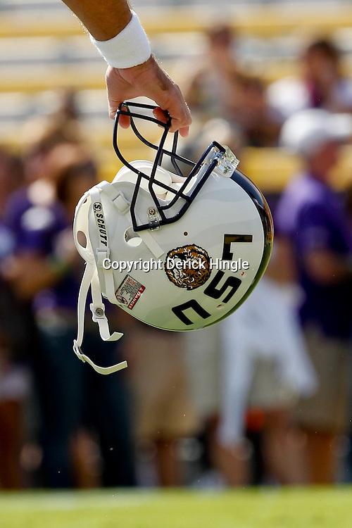 October 22, 2011; Baton Rouge, LA, USA; LSU Tigers quarterback Jarrett Lee (12) holds is helmet prior to kickoff of a game against the Auburn Tigers at Tiger Stadium.  Mandatory Credit: Derick E. Hingle-US PRESSWIRE / © Derick E. Hingle 2011