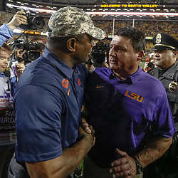 Sep 23, 2017; Baton Rouge, LA, USA; LSU Tigers head coach Ed Orgeron and Syracuse Orange head coach Dino Babers meet following a game at Tiger Stadium. LSU defeated Syracuse 35-26. Mandatory Credit: Derick E. Hingle-USA TODAY Sports