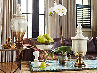 Photographed for their catalogs, convention banners, and website, Pomeroy - Home designs, creates, and distributes a variety of home furnishings such as candle aubras, lamps, banquet ware, vases, and more. Their items are sold in retailers such as Target, Walmart, and many others.