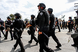 Riot police walking down West street on May 25, 2016 in Anaheim, California.