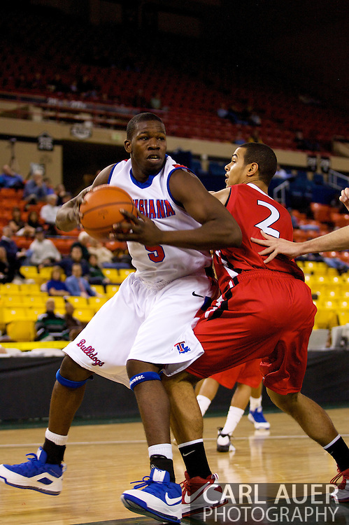 November 27, 2008: Louisiana Tech guard Olu Ashaolu (5) spins around Seattle University's Aaron Broussard (2) in the opening round of the 2008 Great Alaska Shootout at the Sullivan Arena