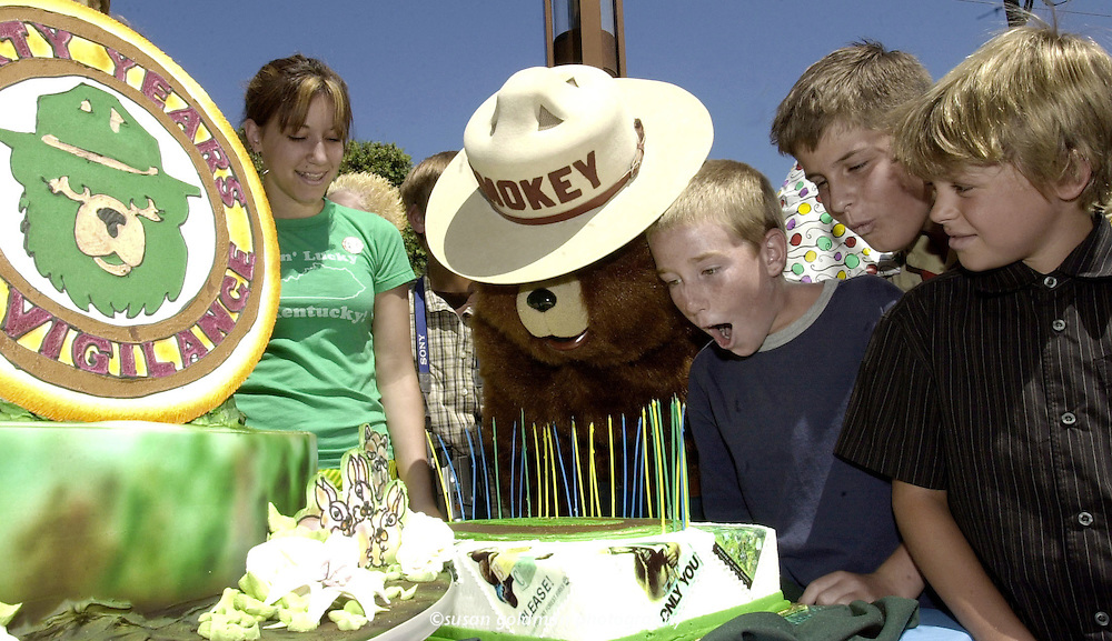 Smokey Bear gets a hand in blowing out the candles on his 60th birthday cake during a birthday party hosted by the Advertising Council, USDA Forest Service and the National Association of State Foresters at Universal Amphitheater in Universal City, Calif. Although there has been a 62 percent reduction in wildfires over the 60 years, this year over 5.5 million acres have been lost to wildfires, making Smokey Bear's message more critical than ever. From left, Ashley Gomez, Smokey, Noah Linier, Roger Luther and Mark Evan.  Photo/The Advertising Council, Susan Goldman.