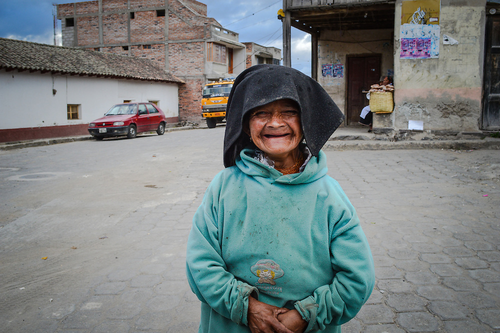 This old lady was begging for some change while I was visiting the town of Peguche Ecuador. I gave her couple of dollars and in exchange she let me take a picture of her & her smile was innocence.
