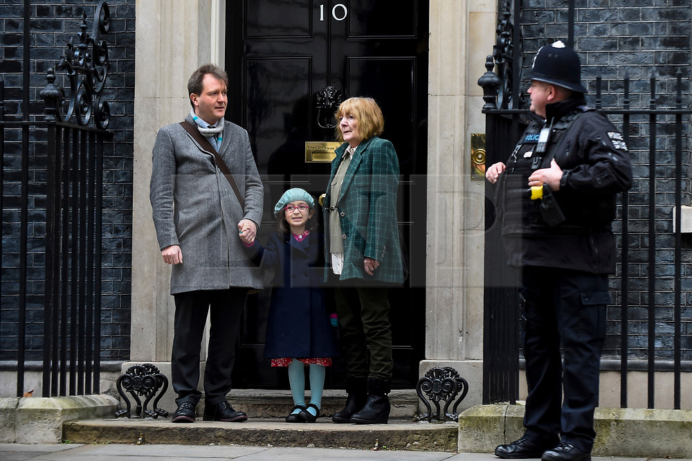 © Licensed to London News Pictures. 23/01/2020. LONDON, UK.  Richard Ratcliffe, the husband of British-Iranian mother Nazanin Zaghari-Ratcliffe, arrives in Downing Street with His mother Barbara and daughter Gabriella for talks with Boris Johnson, Prime Minister.  Mr Ratcliffe wants the Prime Minister to take a personal interest in seeking a release of his wife who was imprisoned in 2016 for five years in Iran on controversial spying charges.  Mr Johnson, when he was Foreign Secretary, was accused of increasing her sentence by saying that she was training journalists in Iran at the time of her arrest.  Photo credit: Stephen Chung/LNP