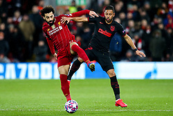 Mohamed Salah of Liverpool challenges Renan Lodi of Atletico Madrid - Mandatory by-line: Robbie Stephenson/JMP - 11/03/2020 - FOOTBALL - Anfield - Liverpool, England - Liverpool v Atletico Madrid - UEFA Champions League Round of 16, 2nd Leg