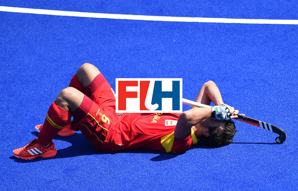 Spain's Miguel Delas lies on the pitch at the end of the men's quarterfinal field hockey Spain vs Argentina match of the Rio 2016 Olympics Games at the Olympic Hockey Centre in Rio de Janeiro on August 14, 2016. / AFP / MANAN VATSYAYANA        (Photo credit should read MANAN VATSYAYANA/AFP/Getty Images)