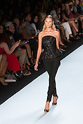 Black pants with strapless sequined top. By Monique Lhuillier at Spring 2013 Fall Fashion Week in New York.
