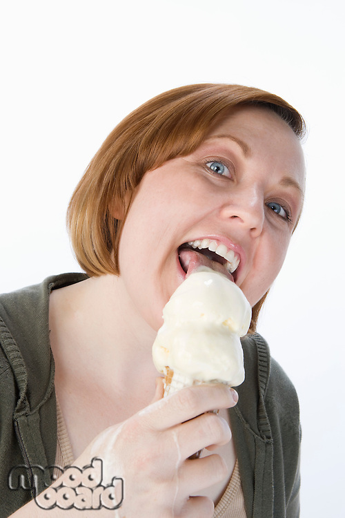 Mid-adult woman eating ice cream, portrait
