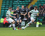 Dundee's Jim McAlister bursts between Celtic's Stefan Johansen and Charlie Mulgrew -  Celtic v Dundee, SPFL Premiership at Dens Park<br /> <br />  - &copy; David Young - www.davidyoungphoto.co.uk - email: davidyoungphoto@gmail.com